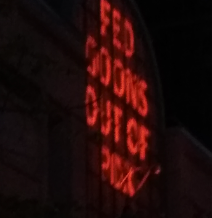 """Projection of words """"Fed Goons ouyt of PDX"""""""