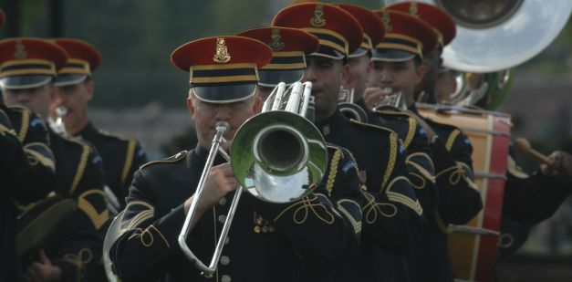 Trombone players in military uniforms